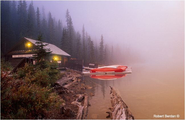 Lake louise boat hourse and canoes in fog by Robert Berdan ©