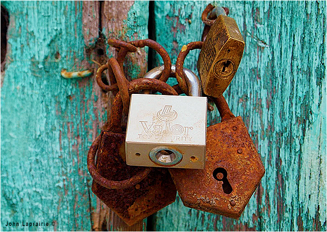 Old locks on door by John Laprairie ©