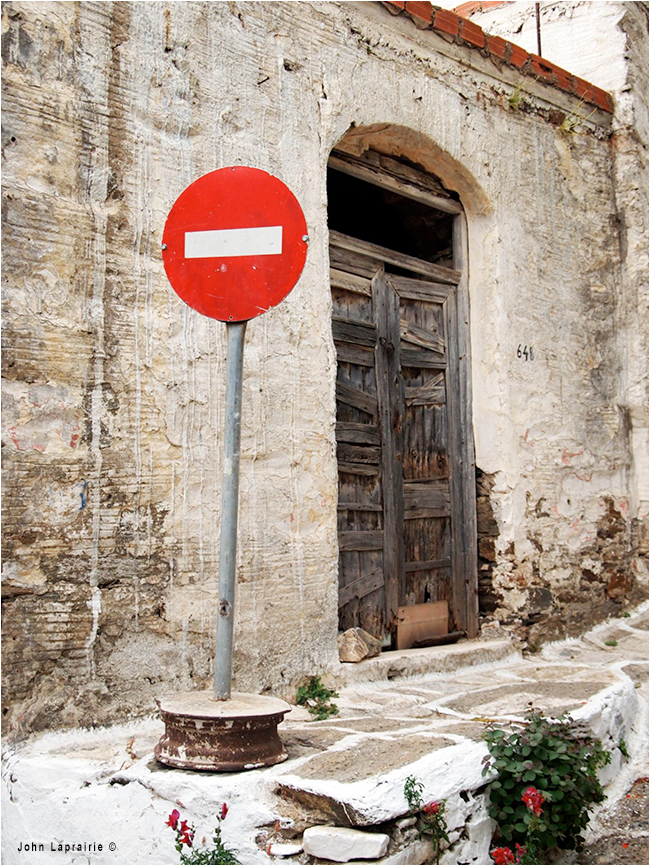 Don not enter in front of old door by John Laprairie ©