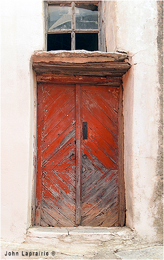 Red door Lefkes, Paros by John Laprairie ©