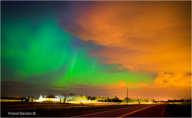 Road, Aurora and City lights reflecting of clouds north of Calgary  by Robert Berdan ©