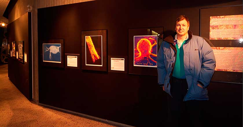 Robert Berdan in front of Science photography exhibit photo by Rinus Borgsteed