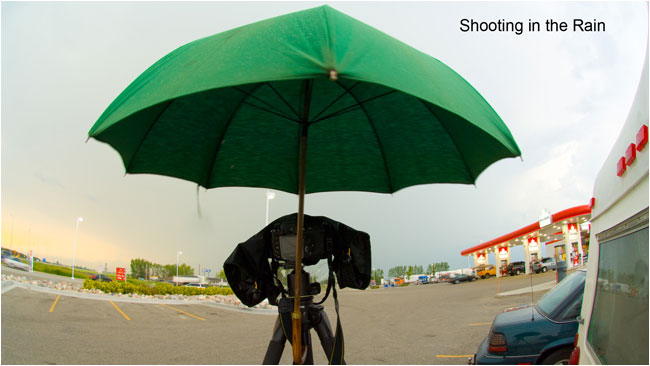 Umbrella attached to tripod