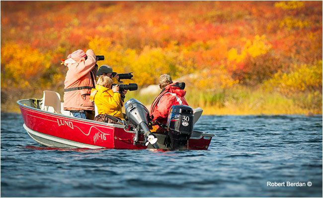 Photographers shooting from small boat on Point Lake by Robert Berdan ©