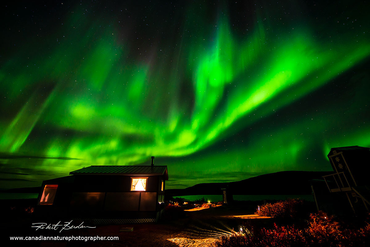 Aurora over the cabins at Point Lake Lodge by Robert Berdan ©