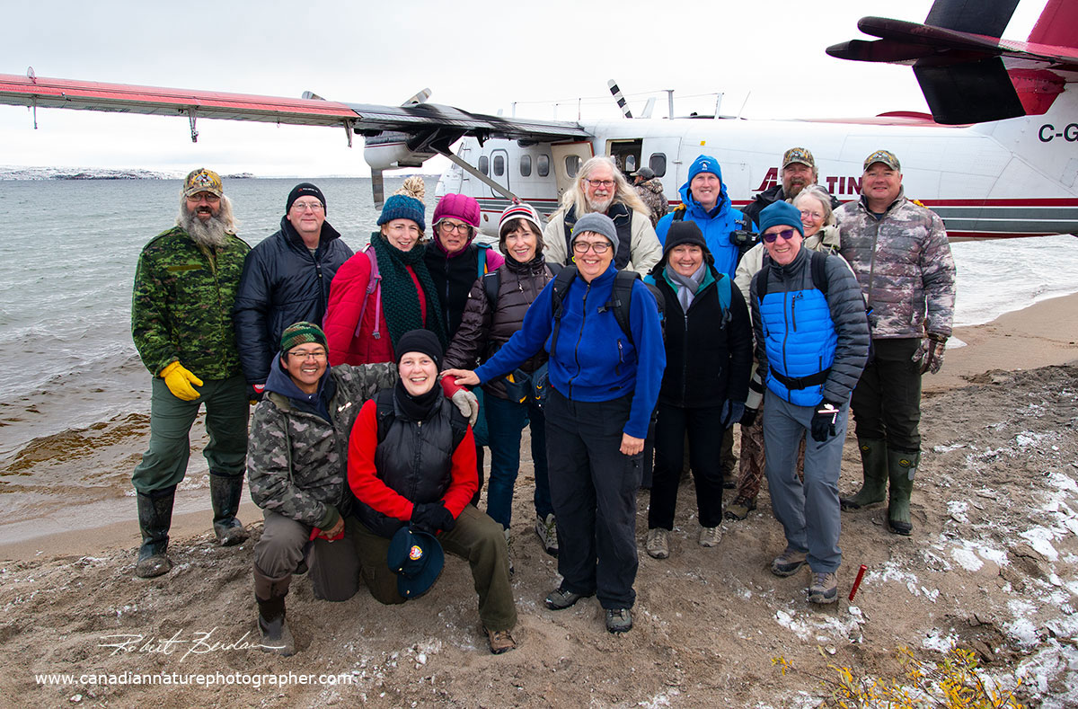 First Group of photographers and guides pose before boarding the Twin Otter for Yellowknife by Robert Berdan ©