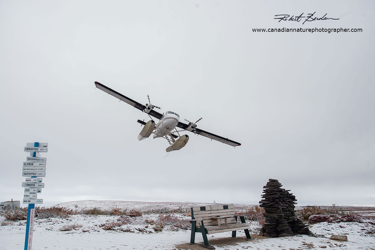 Air Tindi Twin Otter Flying over the lodge at Point Lake by Robert Berdan ©