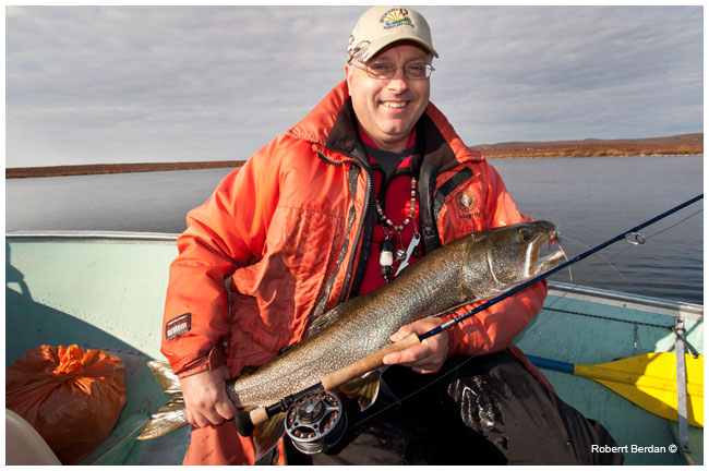 Frank Wood proudly holds a laketrout by Robert Berdan ©