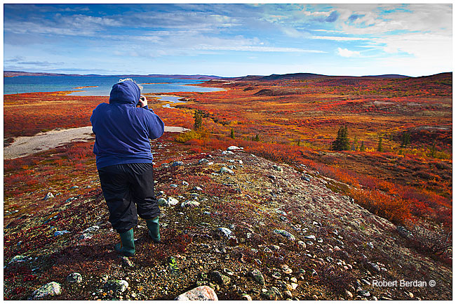 Sonia takes aim with her camera over Esker Bay, NWT by Robert Berdan ©