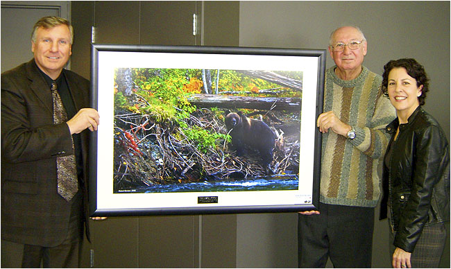 Frank Berdan, Karl Berdan with donated picture taken by Robert Berdan of Grizzly bear in Bellaz Coola.