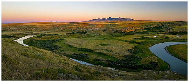 Moonrise panorama over Milk river Writing on Stone Provincial Park, AB by Robert Berdan