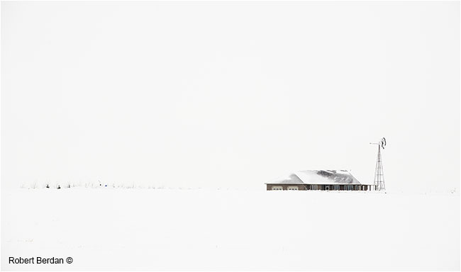 House and water pump in winter field by Robert Berdan ©